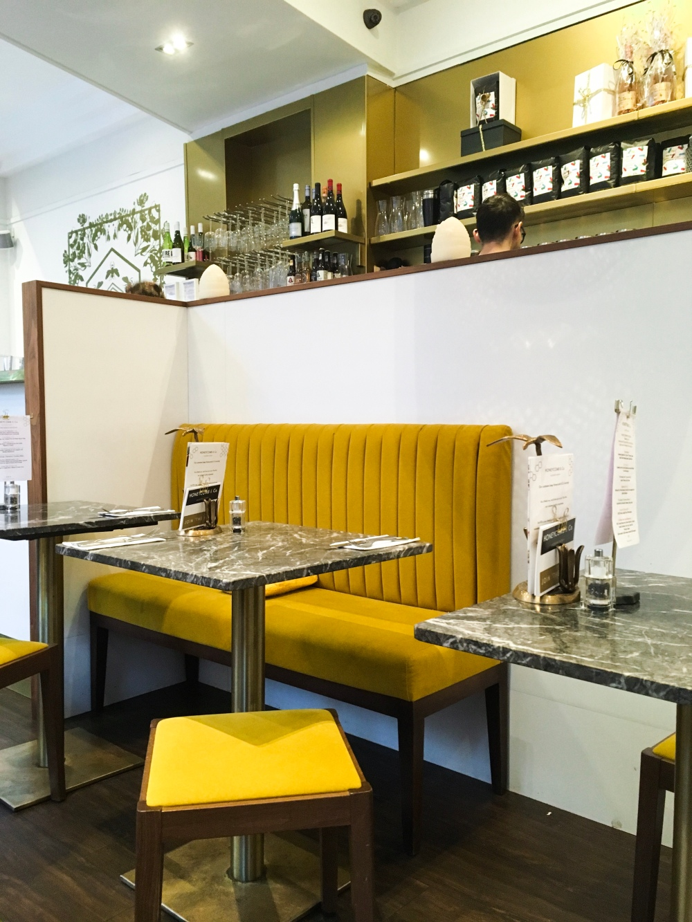a booth table with yellow chairs