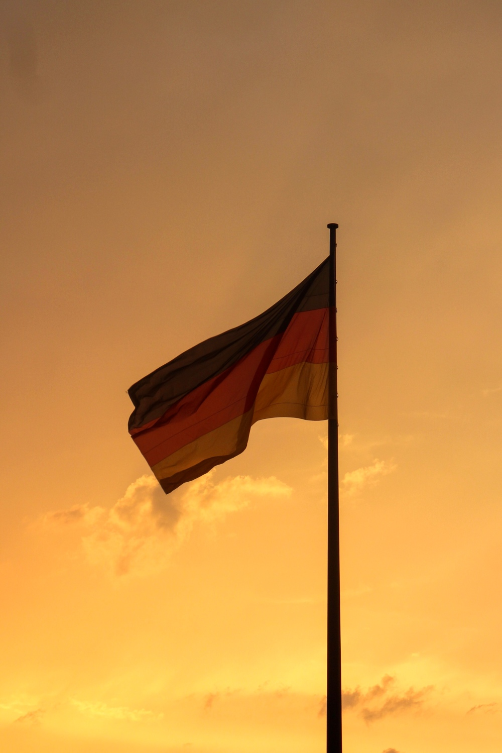 A German flag during sunset