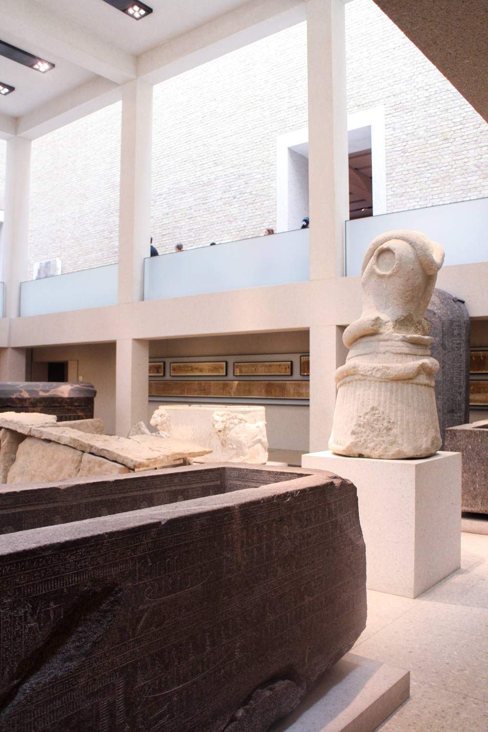 Ancient Egyptian sarcophaguses laid out in a museum
