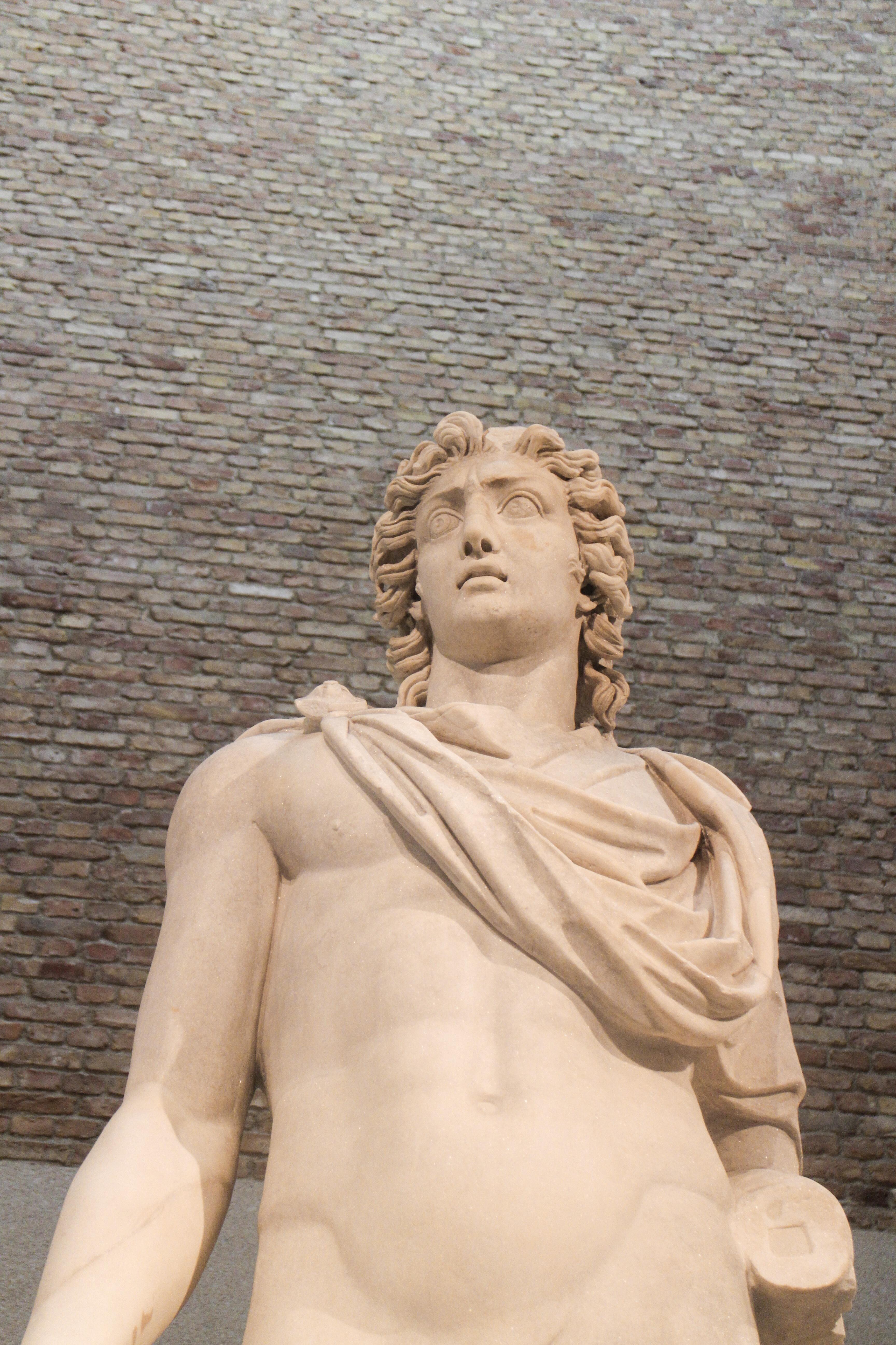 A statue of a Roman God